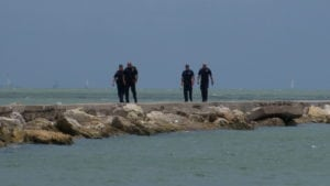 Man's body found floating near USS Lexington