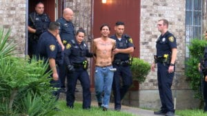 Photo: Suspect being arrested after a short standoff.