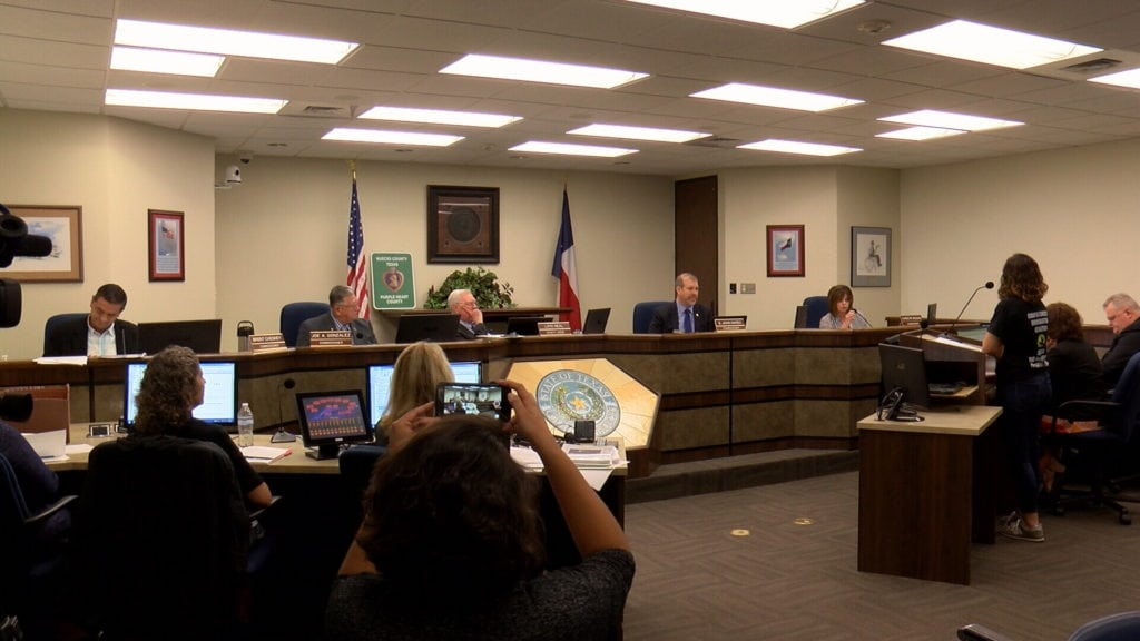 Nueces County Commissioners listen to comments from Dr. Claudia Reyna of the Corpus Christi Immigration Coalition Wednesday